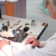 The manual sewing of a custom product is performed to exact tolerances